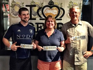 Chad Henderson, Suzie and Todd Ford from NoDa Brewing.